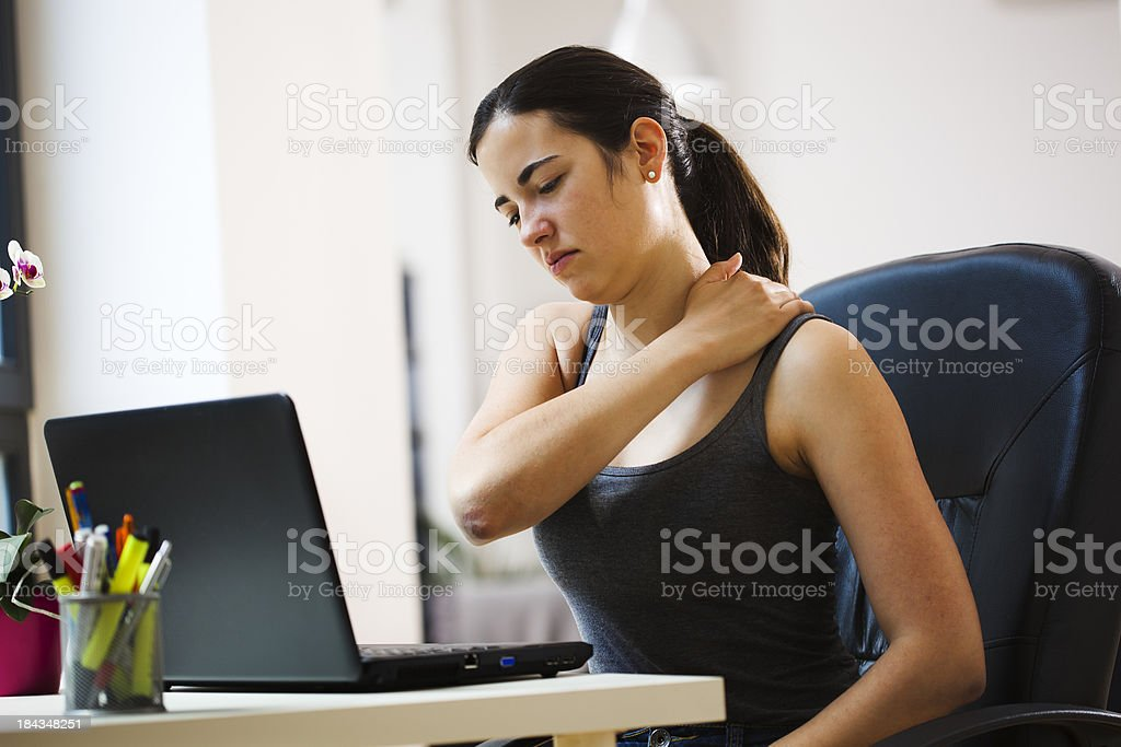 Woman Working With a Sore Back royalty-free stock photo