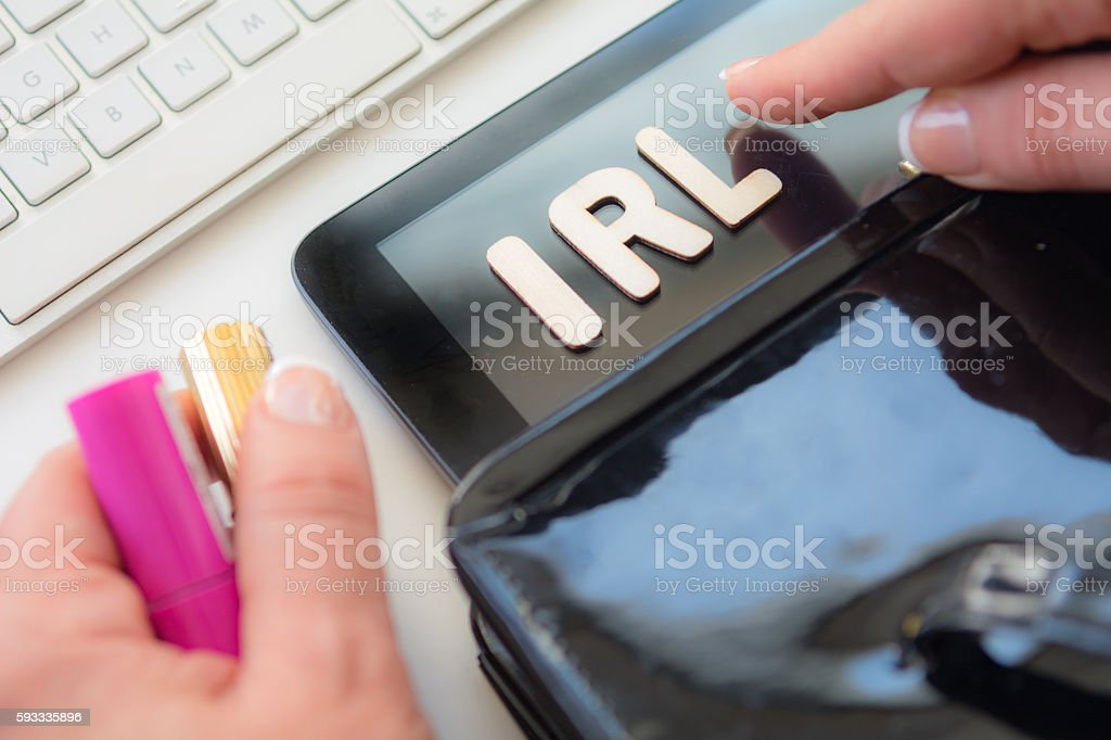 Woman working with abriviation irl on her keyboard stock photo