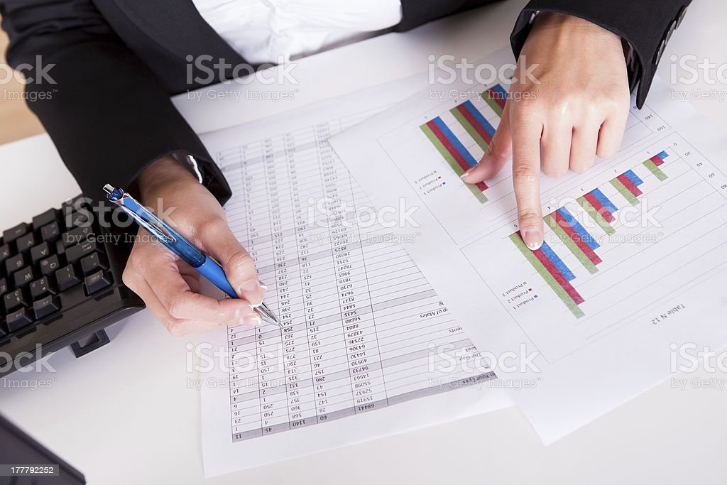 Woman working with bar graphs stock photo