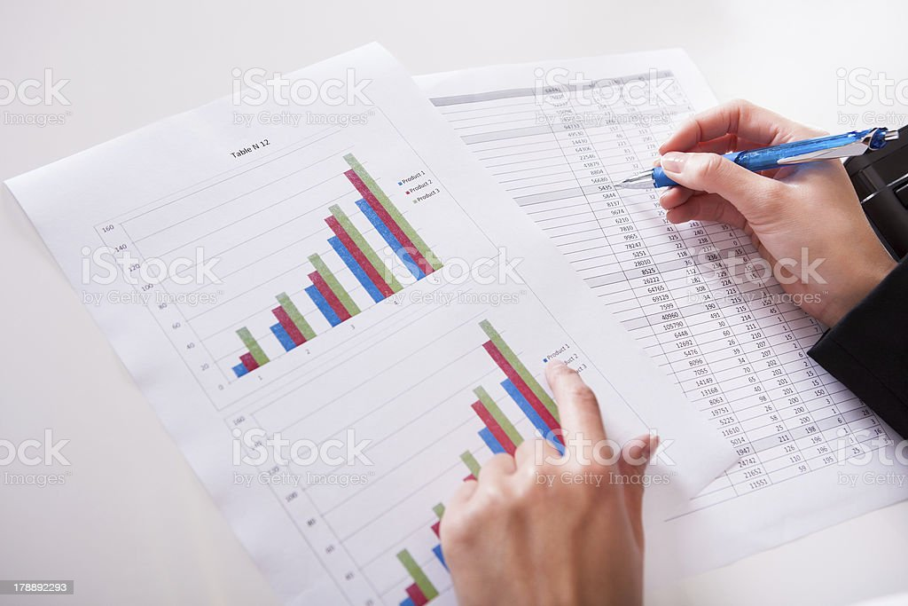 Woman working with bar graphs royalty-free stock photo