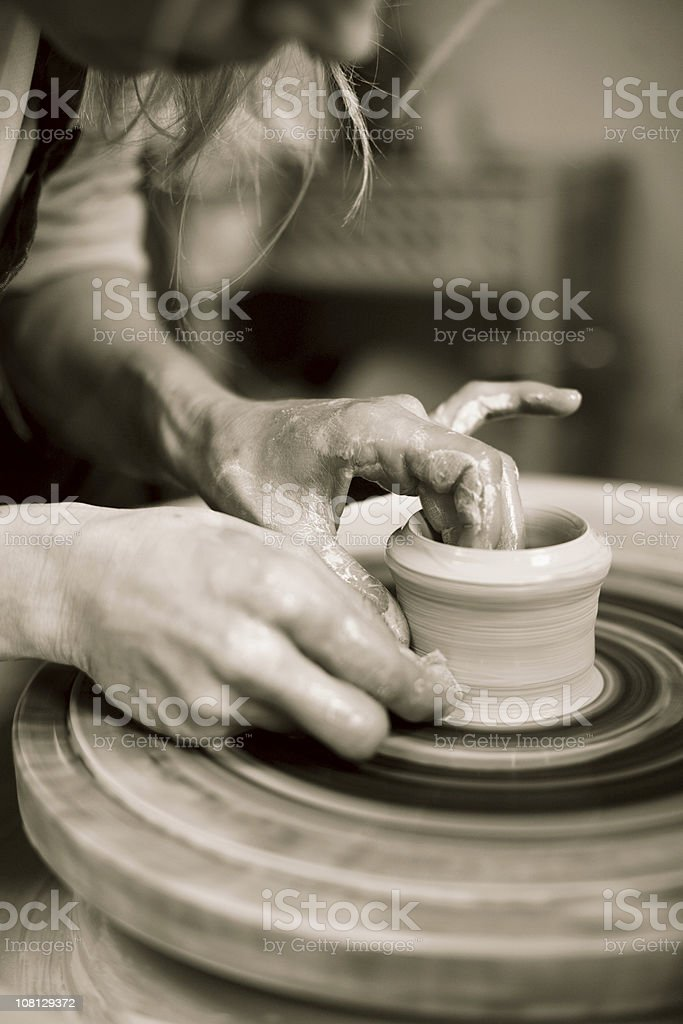 Woman Working with Clay, Sepia Toned royalty-free stock photo