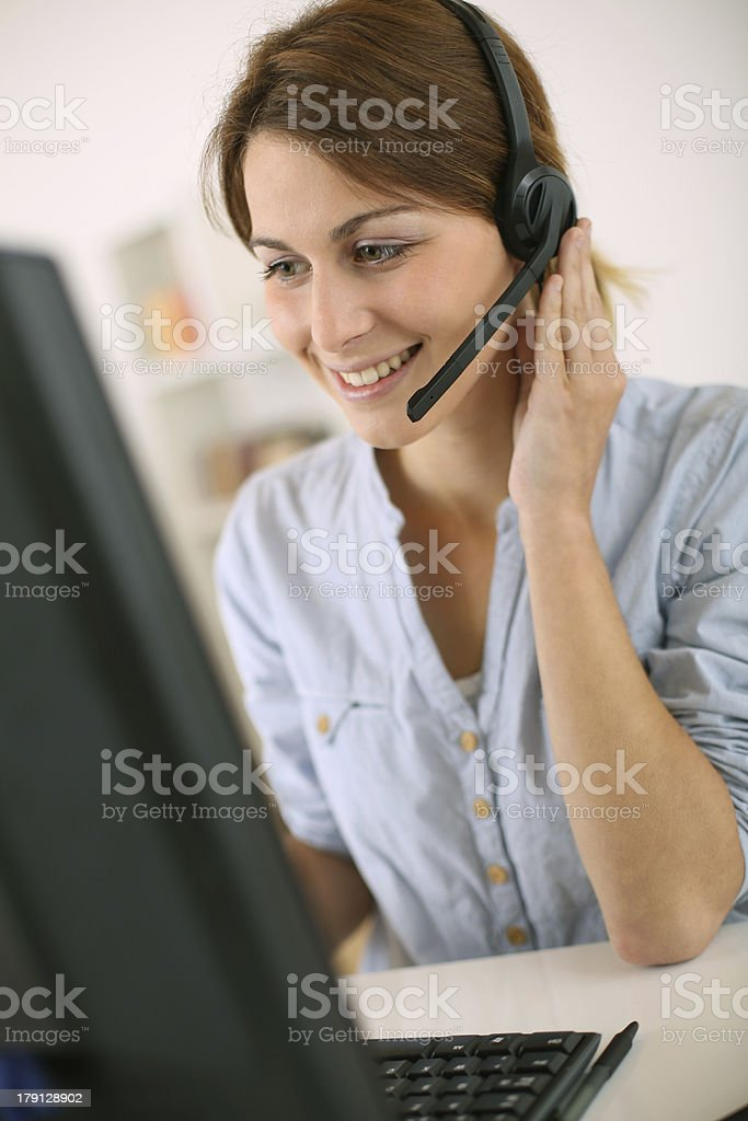 Woman working  with computer and headphone royalty-free stock photo