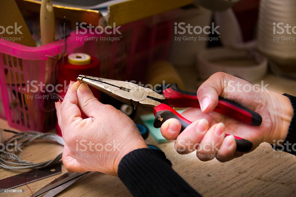 Woman working with pliers royalty-free stock photo