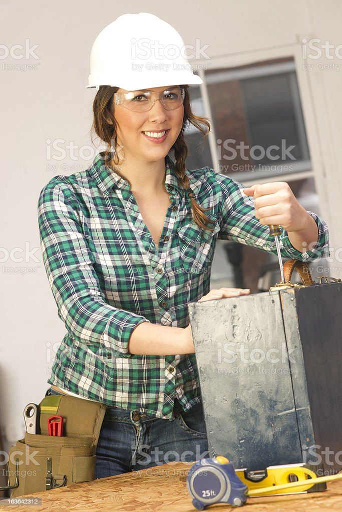 Woman Works Bench Repairing Wooden Box Do it Yourself royalty-free stock photo