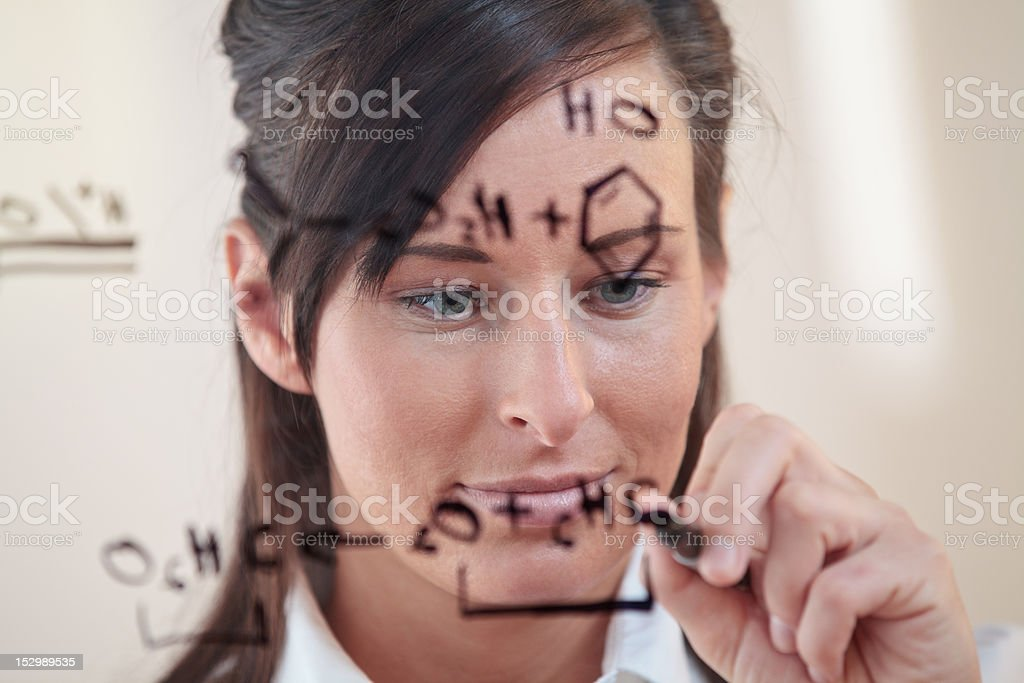 Woman works on an equation royalty-free stock photo