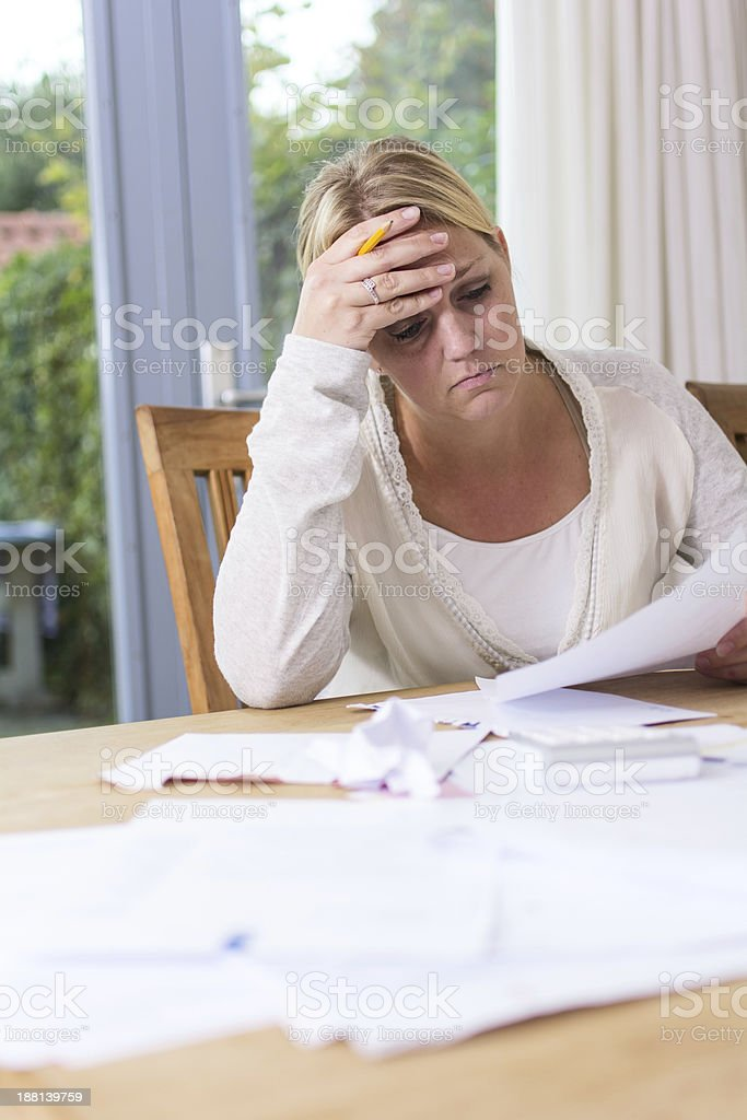 Woman worried about bills stock photo