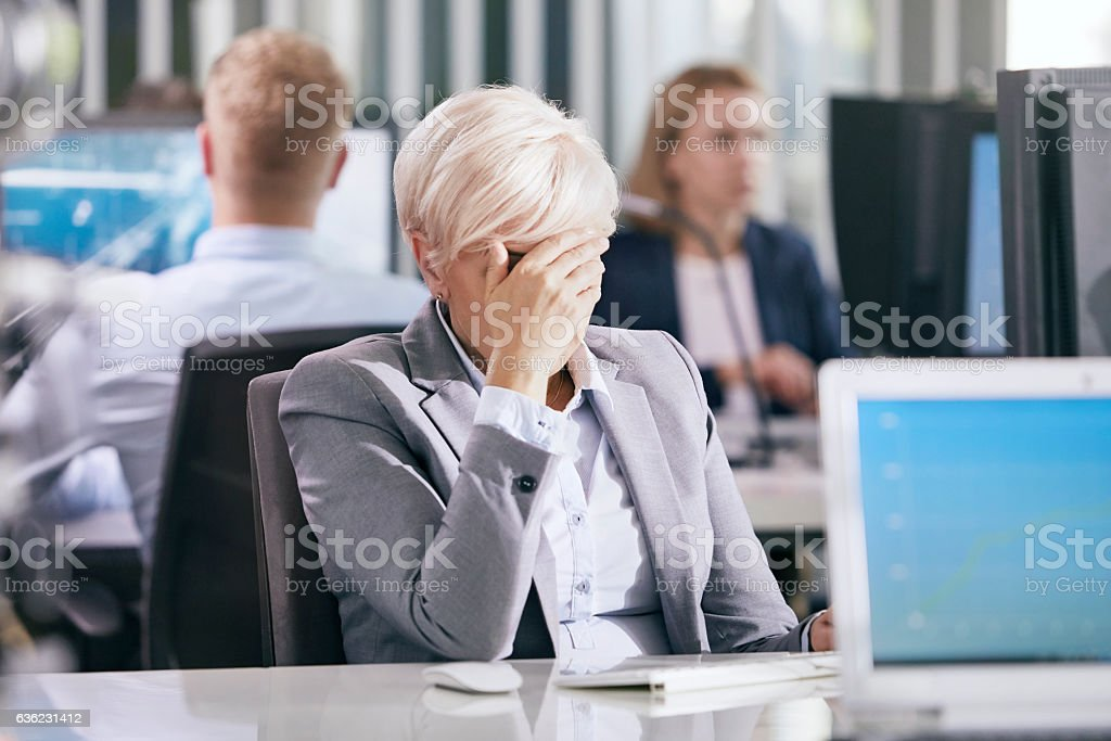 Woman worried at work. Corporate business stock photo