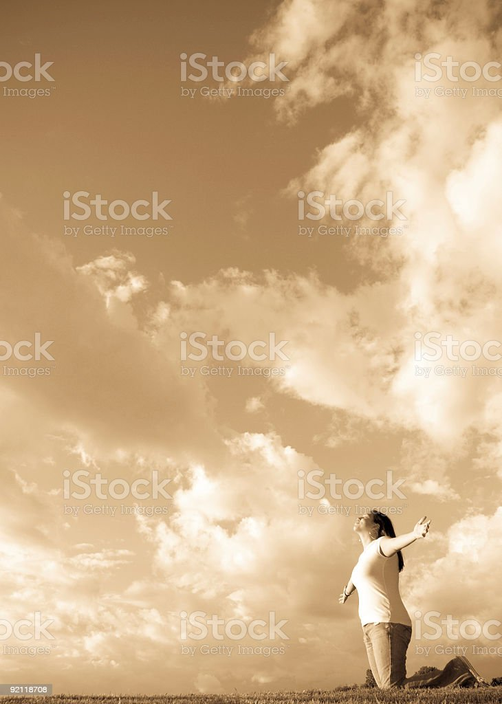 Woman worship and joy on her knees royalty-free stock photo