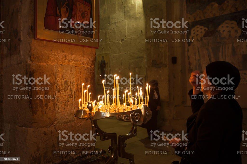 Woman worshiper at Svetitskhoveli Cathedral, Republic of Georgia stock photo