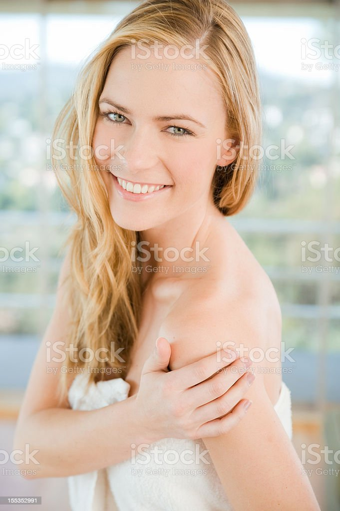 Woman wrapped in a towel stock photo