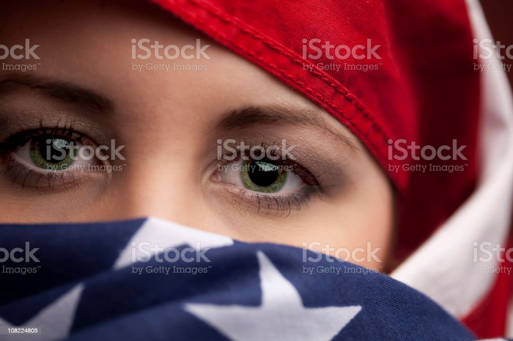 Woman wrapped in an American Flag stock photo