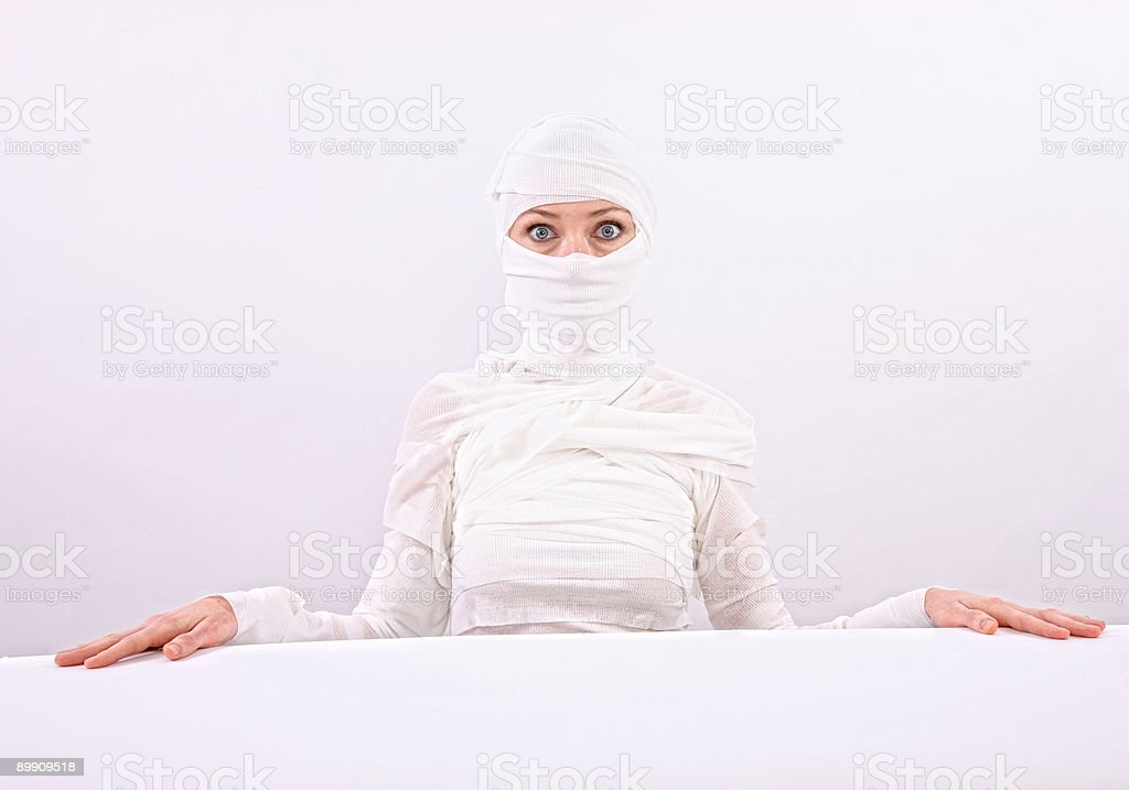 Woman wrapped in bandages royalty-free stock photo