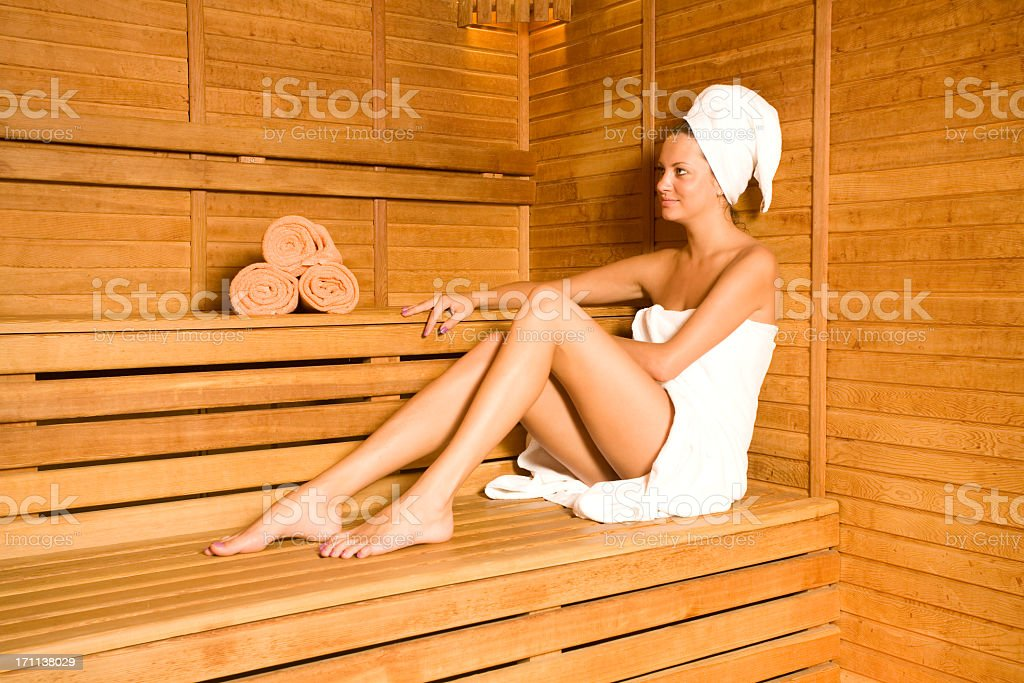 Woman wrapped in towels in sauna stock photo
