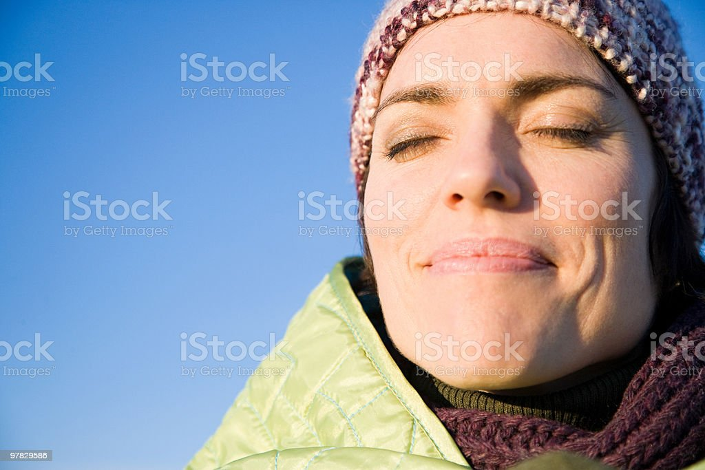 Woman wrapped in warm clothing stock photo