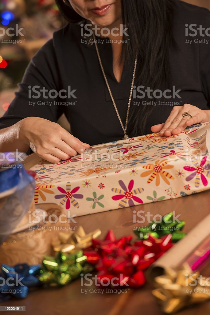 Woman Wrapping Christmas Gifts royalty-free stock photo