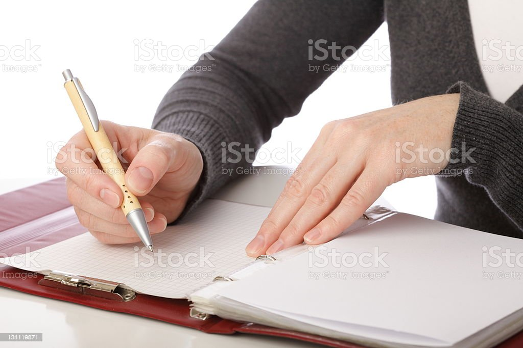 woman write by pen on paper . Isolated royalty-free stock photo
