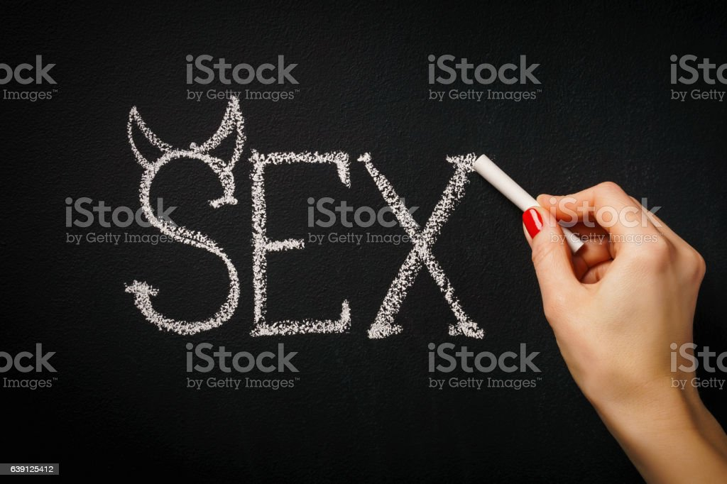 woman writes a word sex stock photo