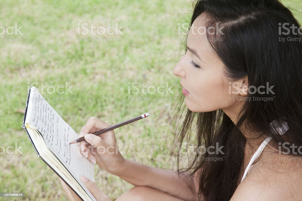 Woman writes in her personal diary royalty-free stock photo