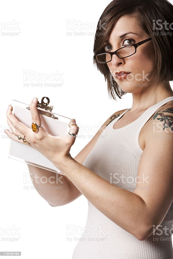 Woman Writes on Clipboard royalty-free stock photo