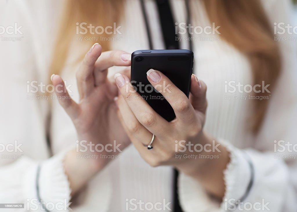 woman writes SMS royalty-free stock photo