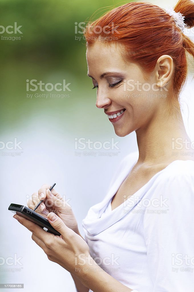 woman writes stylus on screen of device royalty-free stock photo