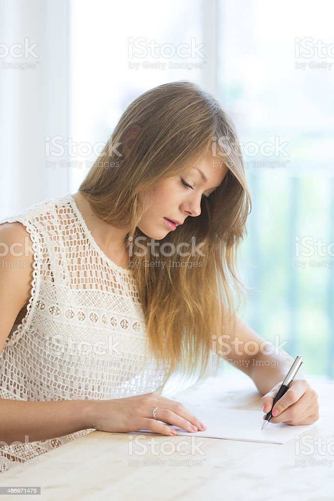 Woman writing a letter stock photo