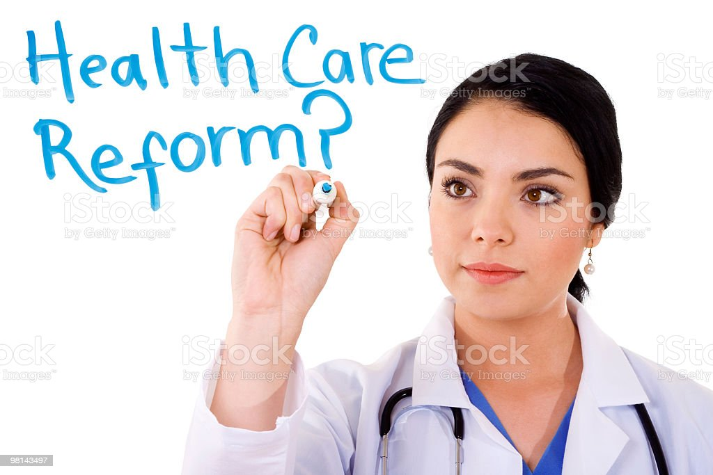 A woman writing health care reform on a board stock photo