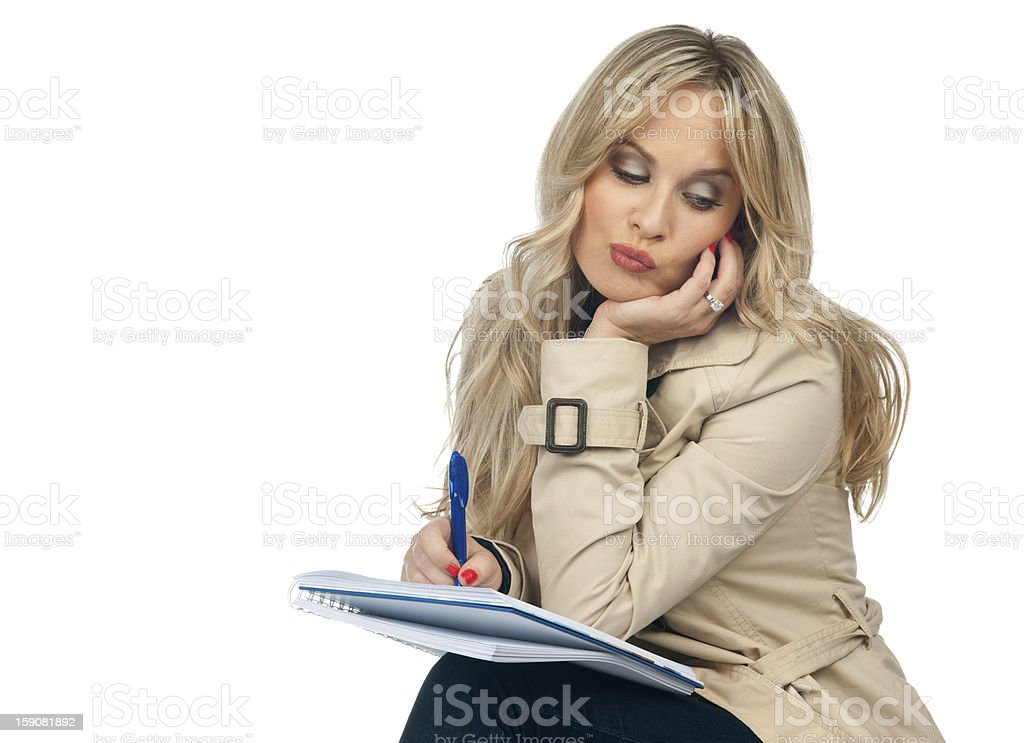 woman writing in the notebook royalty-free stock photo