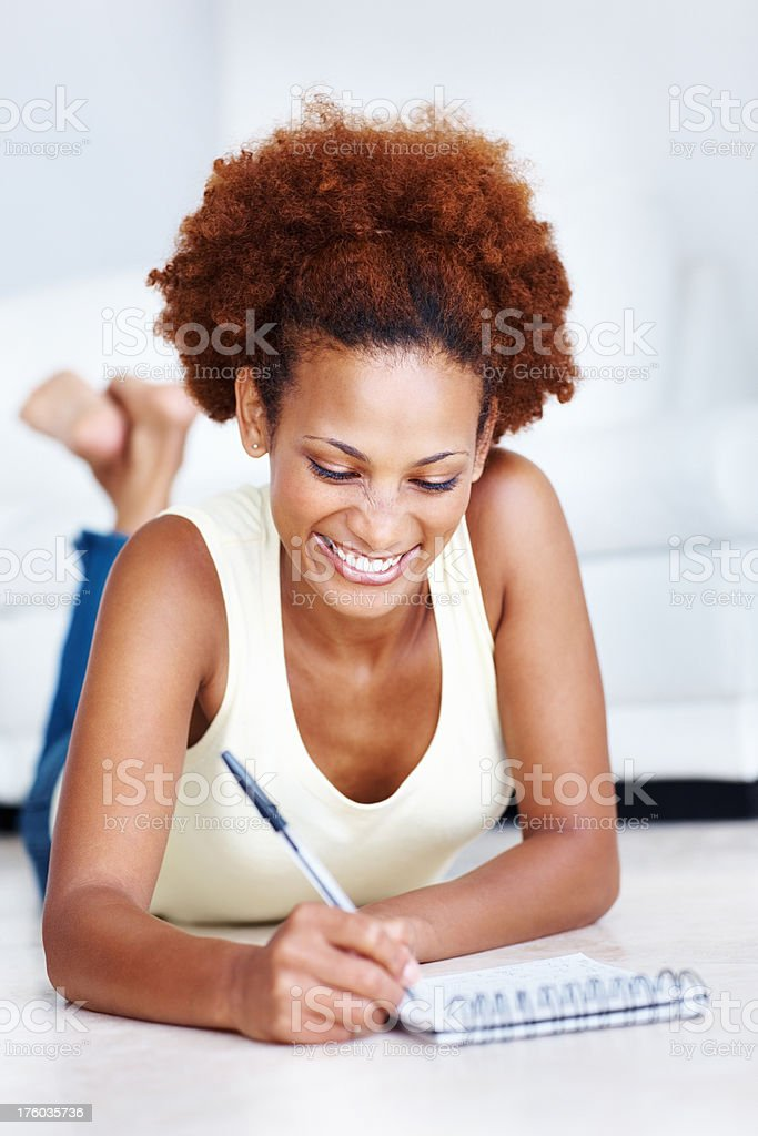 Woman writing notes in notepad stock photo