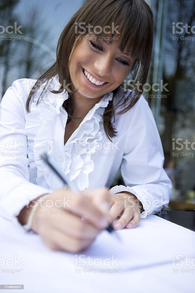 Woman writing royalty-free stock photo