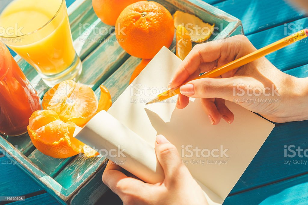 Woman writing stock photo