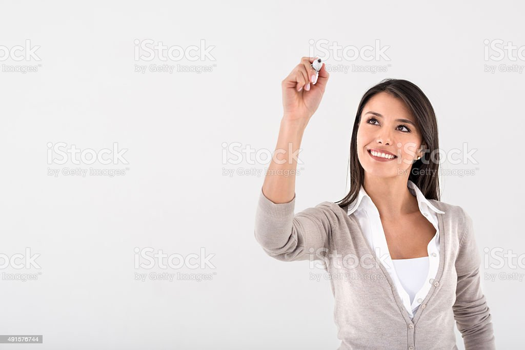 Woman writing with a marker stock photo