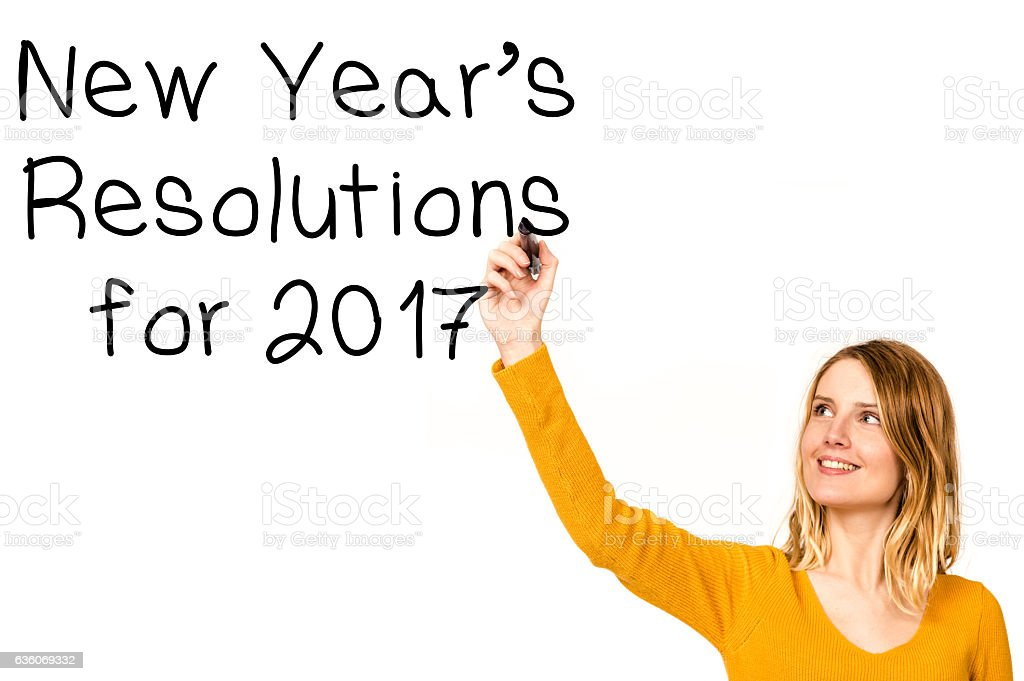 Woman writing with marker the new year resolutions stock photo