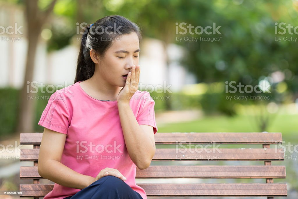 Woman yawning at garden stock photo