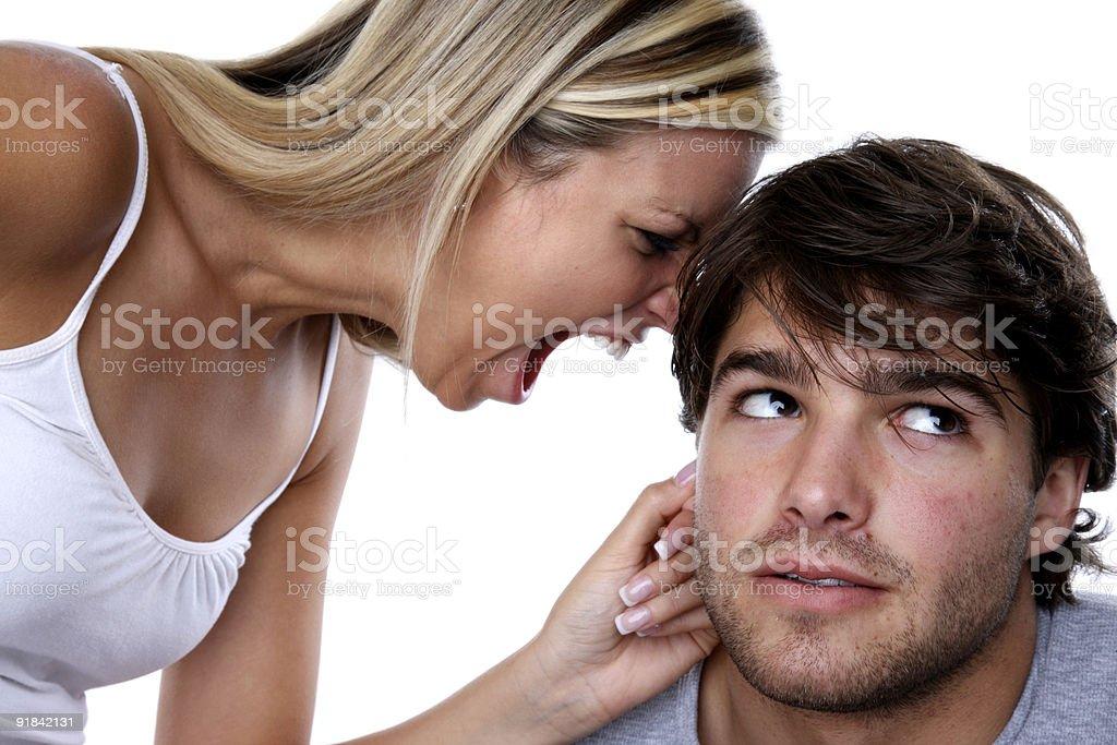 Woman yelling at man stock photo