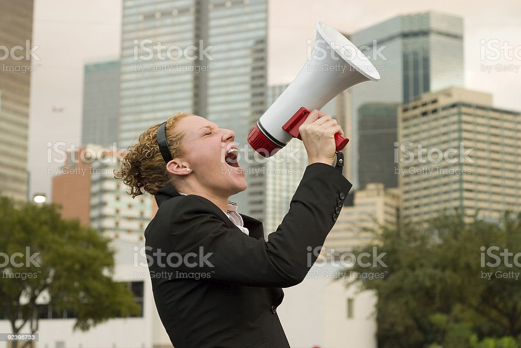 Woman Yelling Into Megaphone In The City royalty-free stock photo