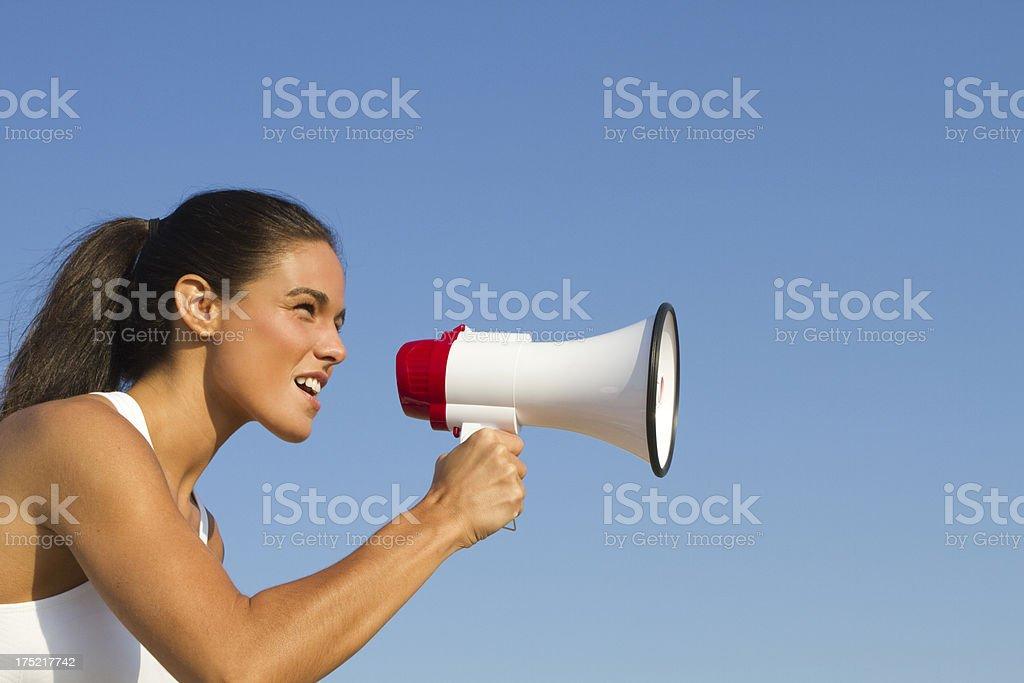 woman yelling into megaphone stock photo