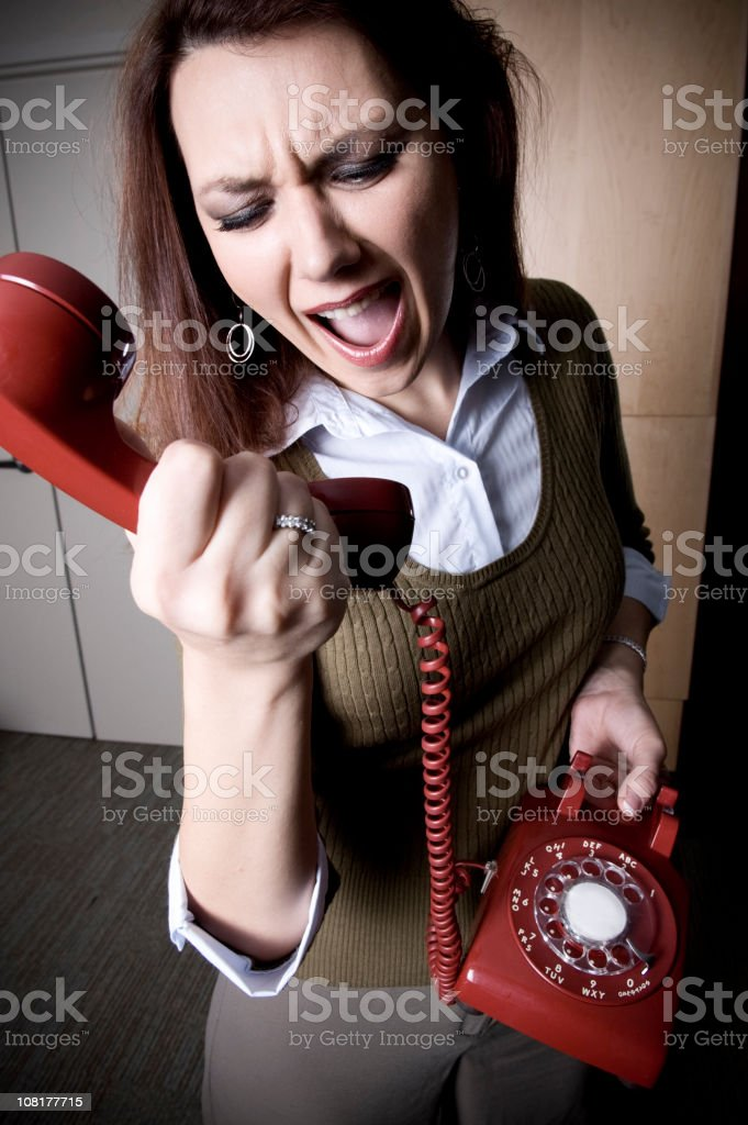 Woman Yelling Into PHone royalty-free stock photo