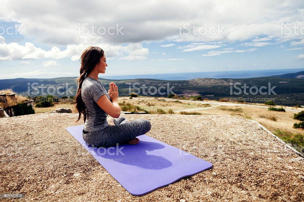 woman yoga practice in mountains stock photo
