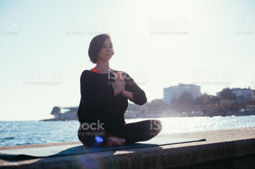 Woman yoga relax on sea side