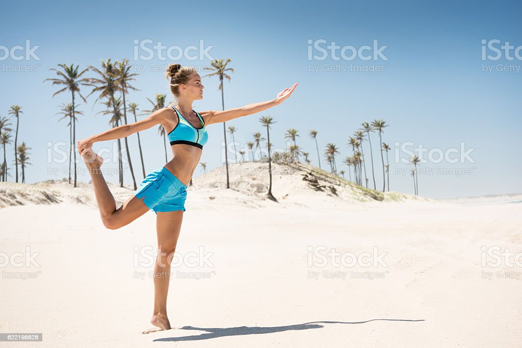 Woman Yoga stretching at the Beach in North Brasil stock photo