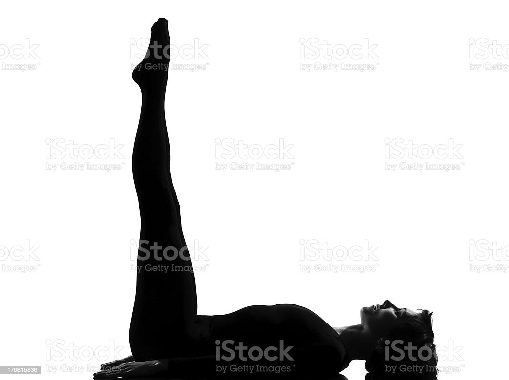 woman yoga Upward Extended Feet Pose - urdhva prasarita padasana stock photo
