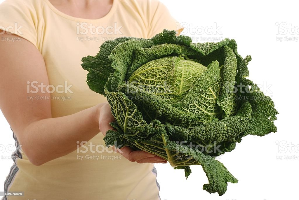 Woman_offering savoy cabbage - isolated stock photo