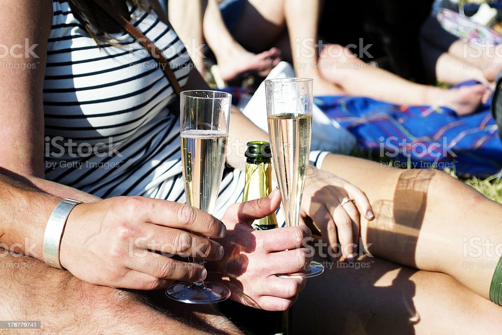 Womand and man holding champagne glasses stock photo