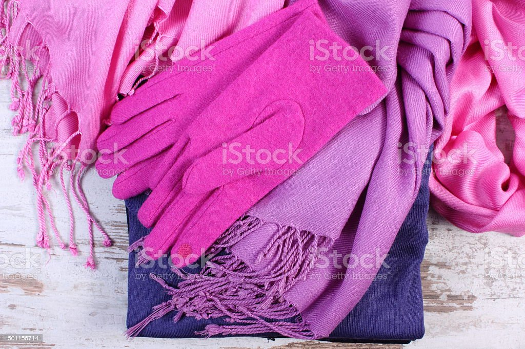Womanly clothes for autumn or winter on old wooden background stock photo