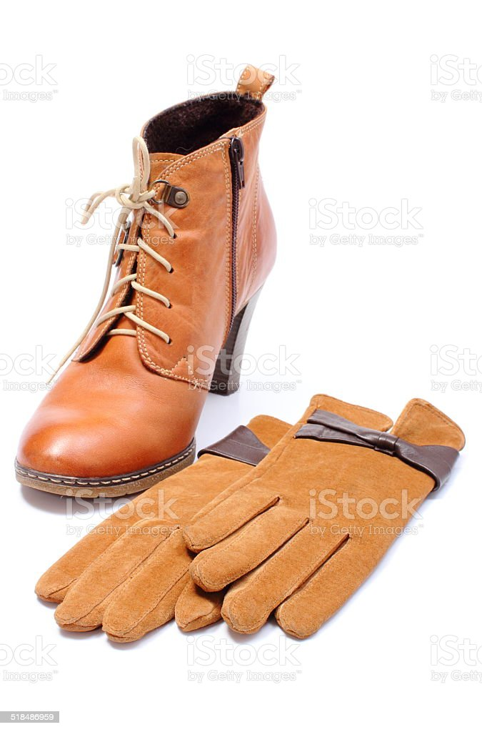 Womanly leather shoes and gloves on white background stock photo