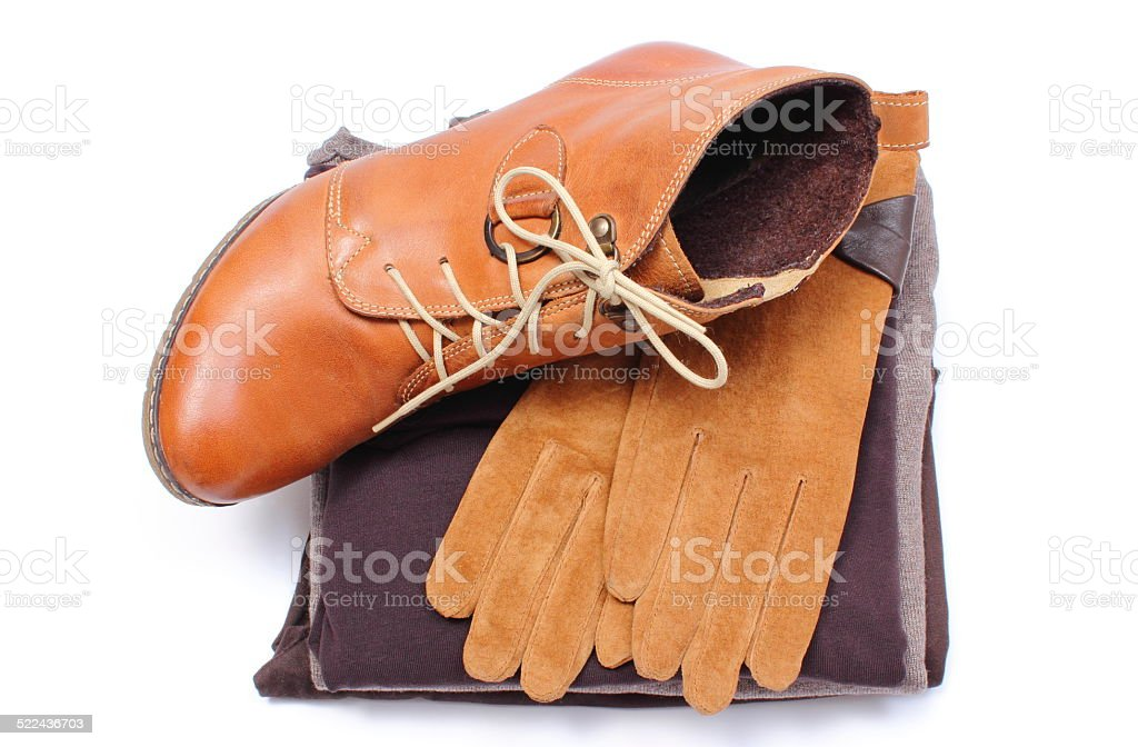 Womanly leather shoes, gloves and clothes on white background stock photo