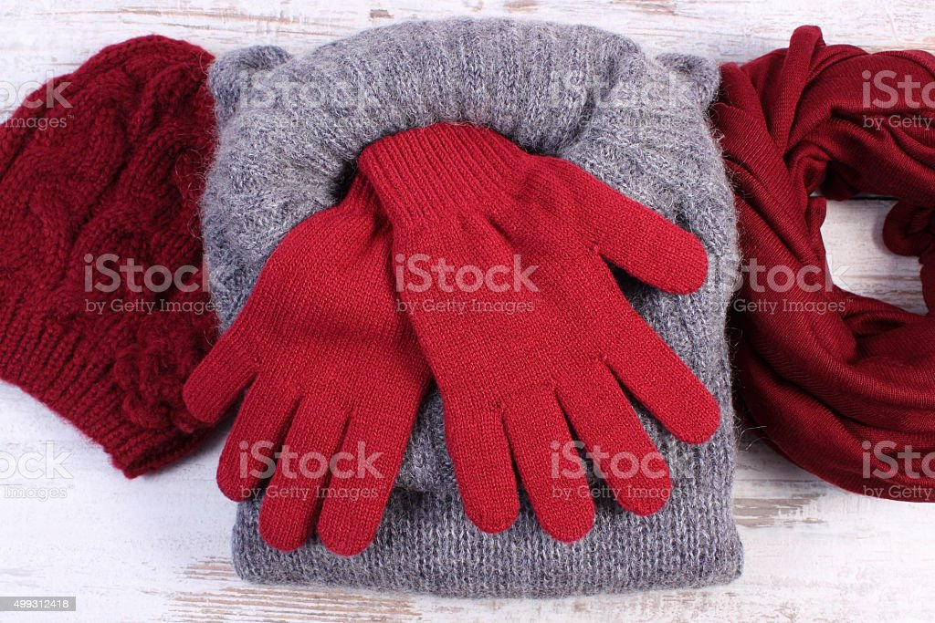 Womanly woolen clothes for winter on old wooden background stock photo