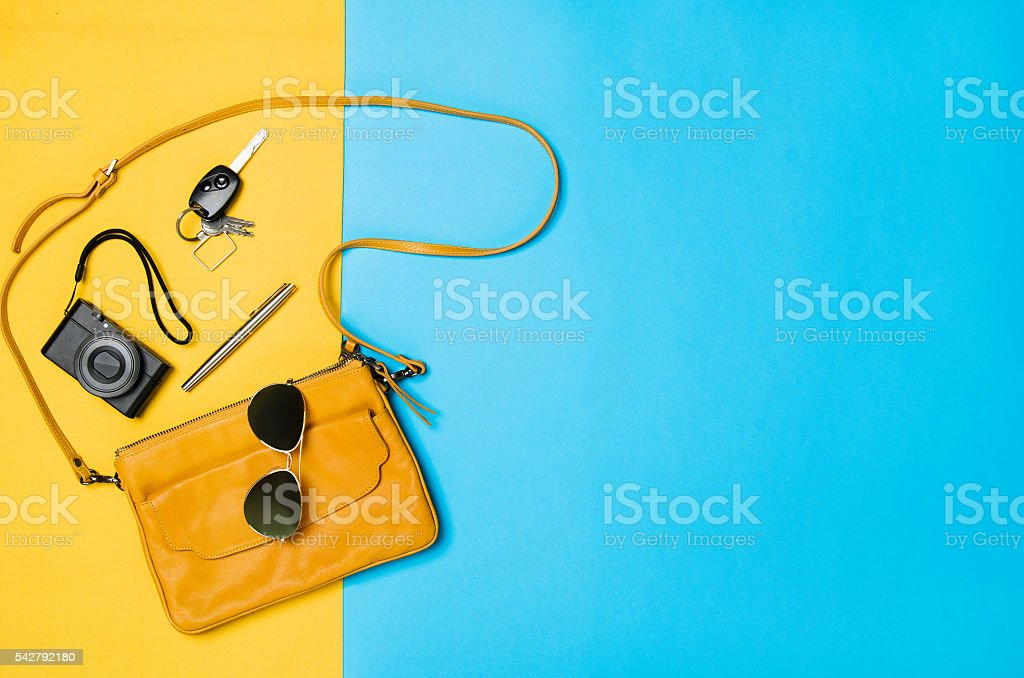 Woman's accessories lying flat on textured fabric background stock photo