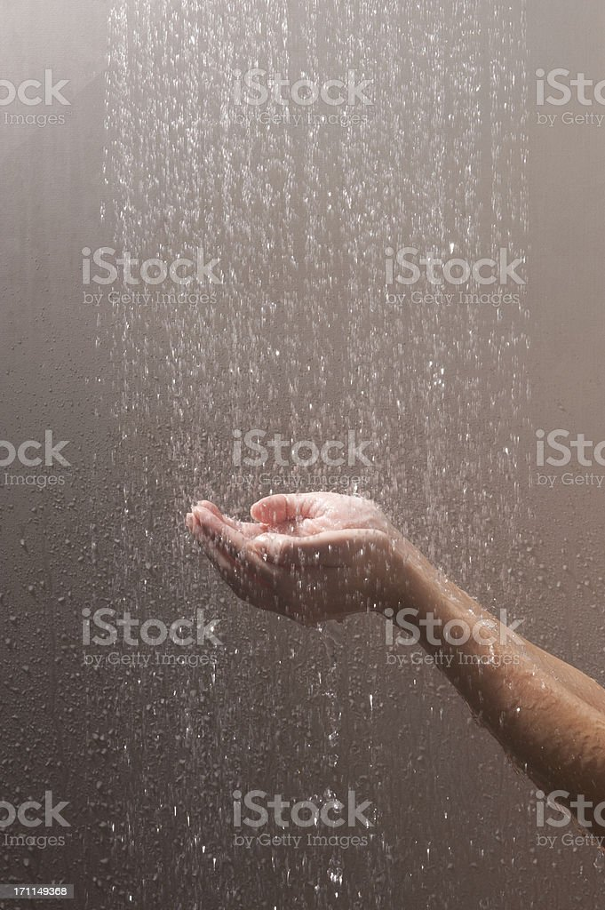 woman's arms and hands in water stock photo
